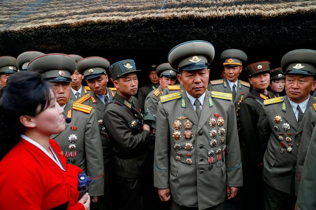 A guide speaks to military officers visiting the birthplace of North Korean founder Kim Il Sung, a day before the 105th anniversary of his birth, in Mangyongdae, just outside Pyongyang. Photo: Reuters