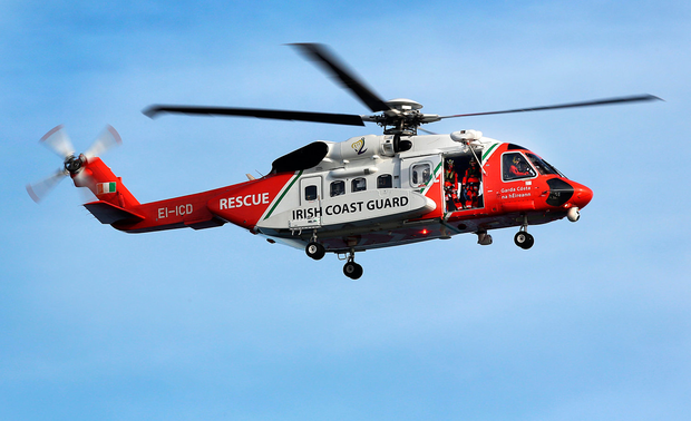 An Irish Coast Guard Helicopter lands at Blacksod Pier as the search continues for Rescue 116. Picture: Steve Humphreys