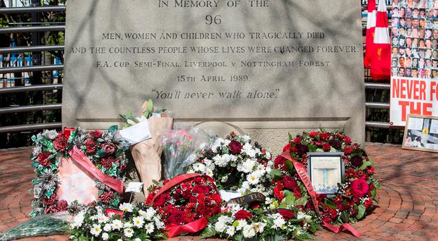 Flowers are placed at the Hillsborough memorial plaque during the Sky Bet Championship match at Hillsborough, Sheffield
