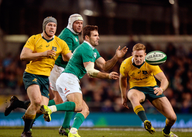 Jared Payne of Ireland in action against David Pocock, left, and Reece Hodge of Australia at the Aviva