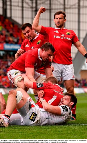 Keith Earls of Munster is congratulated by team-mates Tommy O'Donnell, Niall Scannell and Abrie Griesel