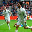 Real Madrid's midfielder Isco (R) celebrates after scoring a goal during the Spanish league football match Real Sporting de Gijon vs Real Madrid CF at El Molinon stadium in Gijon on April 15, 2017. / AFP PHOTO / MIGUEL RIOPAMIGUEL RIOPA/AFP/Getty Images