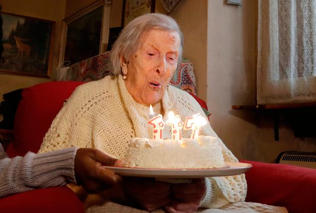 Emma Morano, 117 years old, blows candles on the day of her birthday in Verbania, Italy (AP Photo/Antonio Calanni, File)