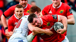 Munster's Peter O'Mahony is tackled by Ulster's Paddy Jackson during yesterday's Guinness PRO12 match at Thomond Park. Photo: Sportsfile