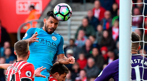 Manchester City striker Sergio Aguero jumps to head his side's third goal against Southampton yesterday. Photo: Getty Images