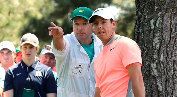 Rory McIlroy listens to caddie JP Fitzgerald's advice on trying a daring punch shot during the final round of the Masters at Augusta National last Sunday Photo: David Cannon/Getty Images