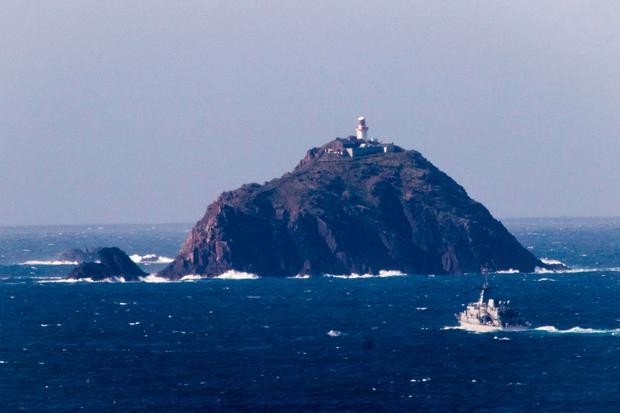 Crash scene: A naval vessel passes Blackrock lighthouse during the search for Rescue 116. According to the crash investigation's initial findings, the rocky outcrop and lighthouse did not exist in the helicopter's flight safety software Picture: Keith Heneghan