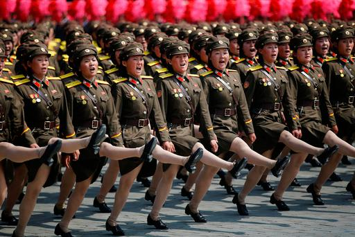 MILITARY MIGHT: North Korean soldiers march and shout slogans during a military parade marking the 105th birth anniversary of the country's founding father, Kim Il-sung, in Pyongyang, North Korea. Photo: Damir Sagolj/Reuters