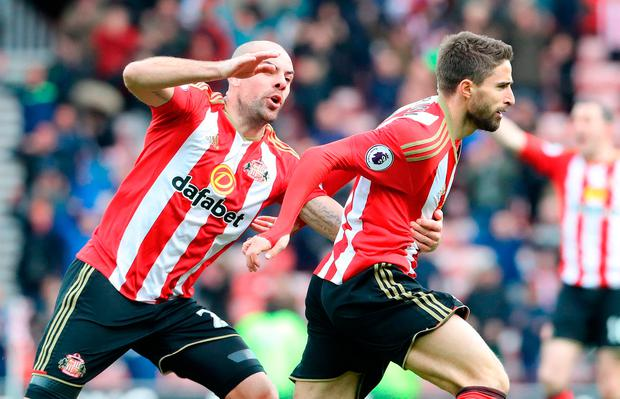 Sunderland's Fabio Borini (right) celebrates scoring his side's second goal of the game Photo: Owen Humphreys/PA Wire
