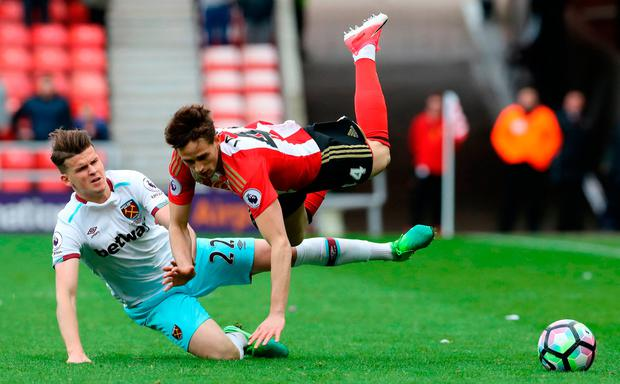 Sunderland's Adnan Januzaj (right) is tackled by West Ham United's Sam Byram Photo: Owen Humphreys/PA Wire