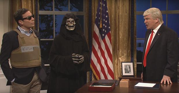 Jimmy Fallon as Jared Kushner, Steve Bannon portrayed as the Grim Reaper and Alec Baldwin as Donald Trump on Saturday Night Live