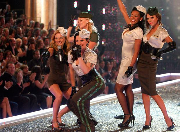 The Spice Girls, Emma Burton, Melanie Chisholm, Geri Halliwell,Melanie Brown, and Victoria Beckham (L to R) perform during the Victoria's Secret fashion show at the Kodak Theatre in Hollywood, California, 15 November 2007. AFP PHOTO / GABRIEL BOUYS (Photo credit should read GABRIEL BOUYS/AFP/Getty Images)