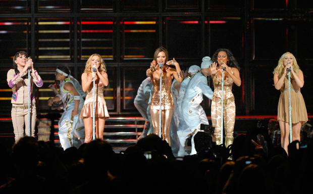 British pop group the Spice Girls, including (from L) Melanie Chisholm, Geri Halliwell, Victoria Beckham, Melanie Brown and Emma Bunton perform at General Motors Place in Vancouver, British Columbia, 02 December 2007.