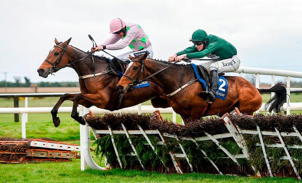 Augusta Kate, right, with David Mullins up, jump the last alongside Let's Dance, with Ruby Walsh up, who finished second, on their way to winning the Irish Stallion Farms European Breeders Fund Mares Novice Hurdle Championship Final during the Fairyhouse Easter Festival at Fairyhouse Racecourse in Ratoath, Co Meath. Photo by Cody Glenn/Sportsfile