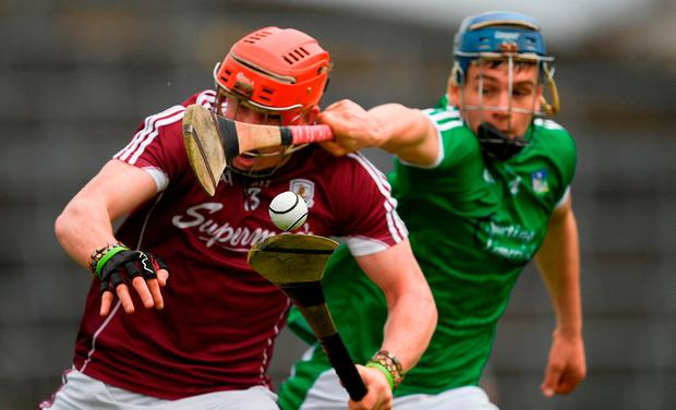 The sliothar is the centre of focus as Conor Whelan of Galway is tackled by Mike Casey of Limerick during the Allianz Hurling League Division 1 Semi-Final match between Limerick and Galway at the Gaelic Grounds in Limerick. Photo by Ray McManus/Sportsfile