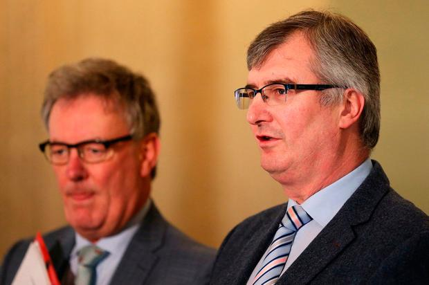 UUP's Tom Elliott (right) and Mike Nesbitt speaking to the media in the Great Hall, Stormont Credit: Brian Lawless/PA Wire