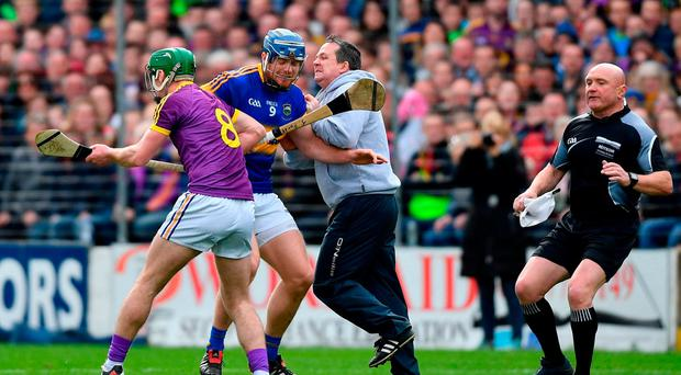 Wexford manager Davy Fitzgerald tussles with Jason Forde of Tipperary during the Allianz Hurling League Division 1 Semi-Final match between Wexford and Tipperary at Nowlan Park in Kilkenny. Photo by Ramsey Cardy/Sportsfile
