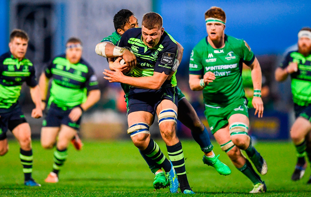 Ross Molony of Leinster is tackled by Bundee Aki of Connacht. Photo by Stephen McCarthy/Sportsfile