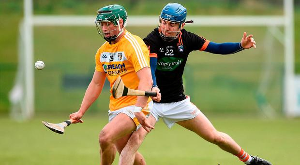Antrim's Conor Johnston in action against Armagh's Peter McKearney. Photo: Oliver McVeigh/Sportsfile