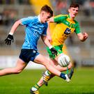 Dublin's Dan O'Brien solos the ball away from Donegal's Jason McGee. Photo: Piaras Ó Mídheach/Sportsfile