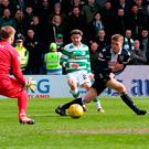 Celtic's Patrick Roberts (centre) scores his sides second goal. Photo credit: Jane Barlow/PA Wire.