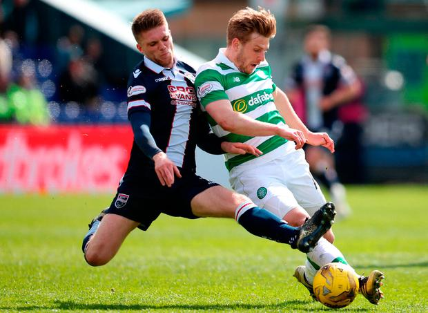 Ross County's Marcus Fraser (left) and Celtic's Stuart Armstrong in action. Photo credit: Jane Barlow/PA Wire