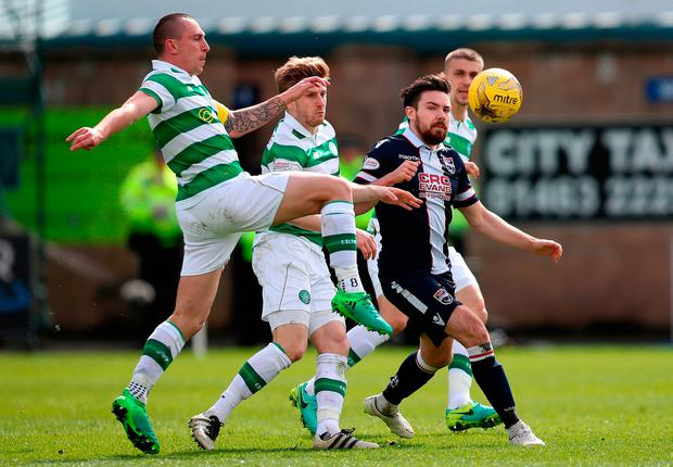 Celtic's Scott Brown (left) and Ross County's Ryan Dow (right) in action. Photo credit: Jane Barlow/PA Wire