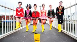Tara Brady, Doireann Ní Ryan, Allah Marsh, Ava Lawrence, Ella Kennedy and Ronan O'Brien dancing in RNLI yellow wellies on the Ha'penny Bridge in Dublin. Photo: Leon Farrell/Photocall Ireland