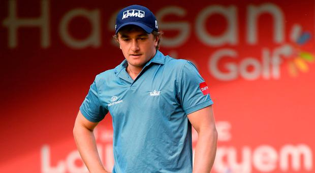 Paul Dunne reacts to missing a putt on the play-off hole. Photo by Stuart Franklin/Getty Images