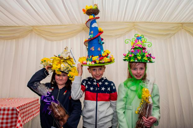 Winners of the Easter Bonnet competition. Zara McKeigue (6), left, in third place, winner Jake Grogan (8), centre, and Margo Gilbrien (7), second place. Photo: Doug O'Connor