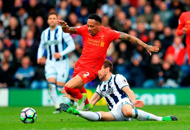 Liverpool's Nathaniel Clyne (left) and West Bromwich Albion's Craig Dawson battle for the ball. Photo credit: Adam Davy/PA Wire