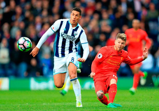 Liverpool's Alberto Moreno (right) shoots from distance towards the end of the game. Photo credit: Adam Davy/PA Wire