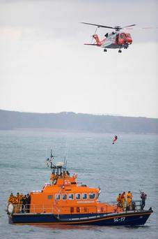 Pictured are the Dunmore Life Boats with the Waterford Coast Guard Helicopter 117 makes a flyby. Photo: Patrick Browne