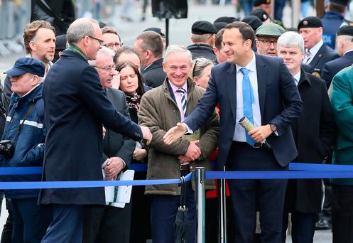 Ministers Simon Coveney, Richard Bruton and Leo Varadkar before the start of the ceremony to mark the 101st anniversary of the Easter Rising at the GPO in Dublin yesterday. Photo: Frank McGrath