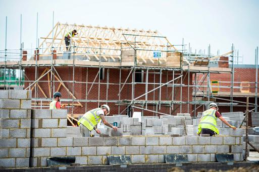 Housing Minister Simon Coveney said the number of liveable houses increased by 15,000 last year. Photo: PA