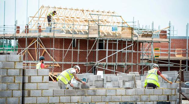 """Housing Minister Simon Coveney has hit out at attempts """"to catch the Government out"""" over the number of new homes being built."""