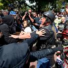 Anti and pro-Donald Trump supporters clash during competing demonstrations in Berkeley, California. Photo: Anda Chu/San Jose Mercury News via AP