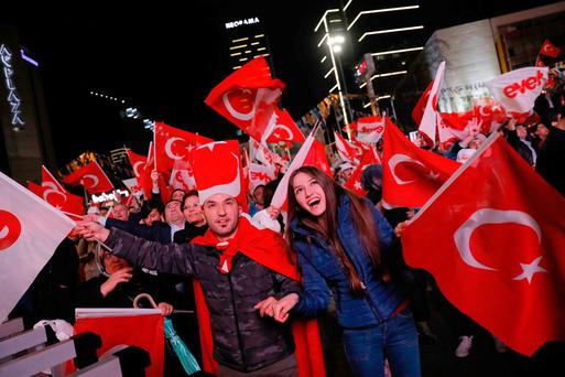 Supporters of AK party react in Ankara, Turkey. Photo: Umit Bektas/Reuters