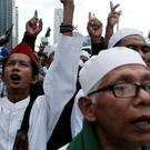 Members of the Islamic Defenders Front (FPI) shout slogans during protest against Jakarta governor Basuki Tjahaja Purnama in Jakarta, Indonesia