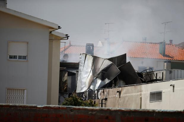 Smoke is seen where a small airplane crashed near a supermarket in a residential area outside Lisbon, Portugal April 17, 2017. REUTERS/Rafael Marchante
