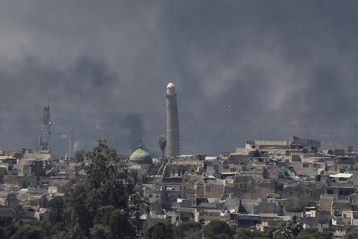 A smoke rises above Al-Nuri mosque in the old city as Iraqi forces fight Islamic State militants in Mosul, Iraq April 17, 2017. REUTERS/Marko Djurica