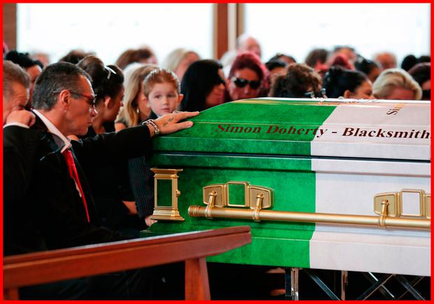 My Big Fat Gypsy Wedding star Paddy Doherty rests his hand on the coffin of his father Simon Doherty during his funeral service at St Michael's Catholic Church in Ashtead, Surrey. Photo: Yui Mok/PA Wire