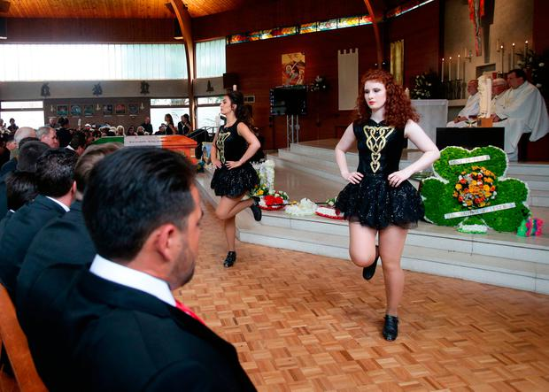 Irish dancers performing at St Michael's Catholic Church in Ashtead, Surrey, during the funeral of Simon Doherty, the father of My Big Fat Gypsy Wedding star Paddy Doherty.Photo: Yui Mok/PA WireWire