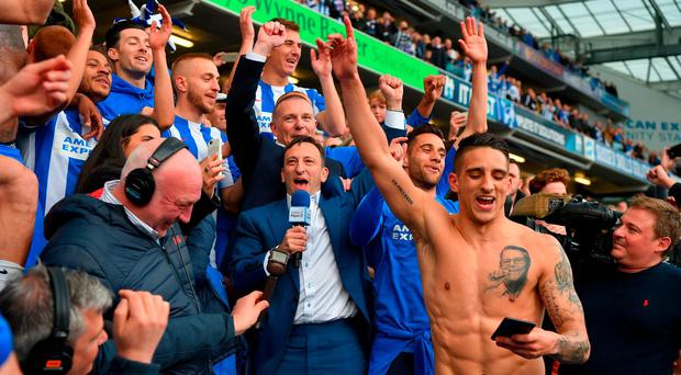 Brighton chairman Tony Bloom and Anthony Knockhaert (R) salute the fans at the end of the Sky Bet Championship match between Brighton & Hove Albion and Wigan Athletic at Amex Stadium