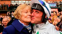 Trainer Jessica Harrington kisses jockey Robbie Power after winning the Boylesports Irish Grand National Steeplechase with Our Duke during the Fairyhouse Easter Festival at Fairyhouse Racecourse in Ratoath, Co Meath. Photo by Cody Glenn/Sportsfile
