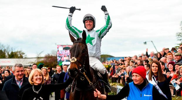 Jockey Robbie Power celebrates as he enters the parade ring after winning the Boylesports Irish Grand National Steeplechase on Our Duke during the Fairyhouse Easter Festival at Fairyhouse Racecourse in Ratoath, Co Meath. Photo by Cody Glenn/Sportsfile
