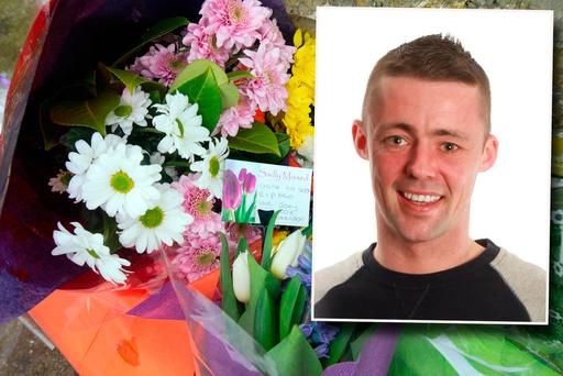 Flowers at the scene of the murder of Stephen Lynch (inset)