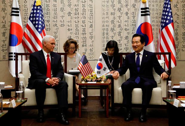 U.S. Vice President Mike Pence talks with National Assembly Speaker Chung Sye-kyun during their meeting in Seoul, South Korea, April 17, 2017. REUTERS/Kim Hong-Ji