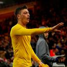 Arsenal's Mesut Ozil gives his shirt to fans after the game