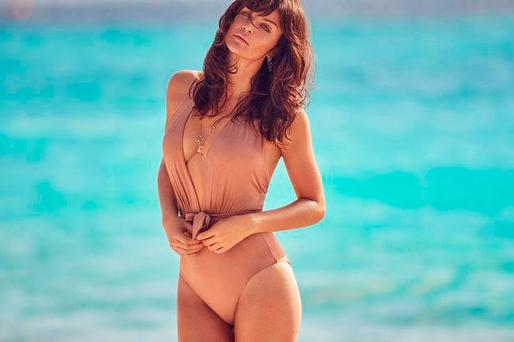 Helena Christensen models a Janet Reger nude swimsuit as part of the Debenhams Fashion by Designers range